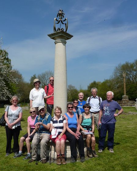 Walkers at the Queen Mother memorial in the churchyard at St Paul's Walden.