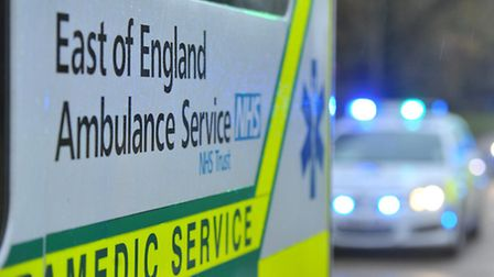 An air ambulance has landed to attend to a man with serious injuries after a car overturned between