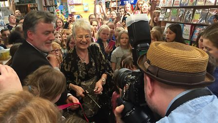 Jacqueline Wilson cutting the ribbon on the new children's section at David's Bookshop in Letchworth