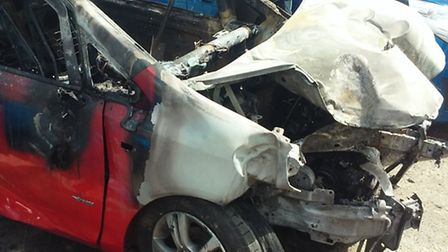 Chloë Ward's Vauxhall Corsa after the crash and the fire.