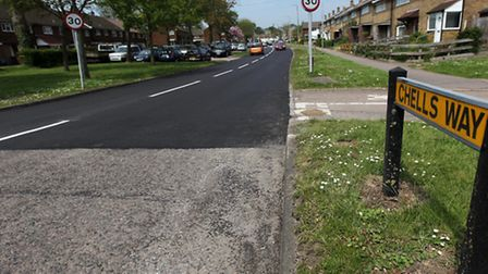 The old surface meets the new in Chells Way, Stevenage.