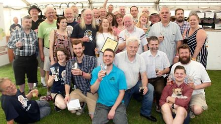 Half Moon staff and regulars at the beer festival as they receive their Camra Herts pub of the year