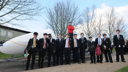 PC Arron Worbey, wearing red, stands on top of the boat at Fearnhill School in Letchworth, his old s