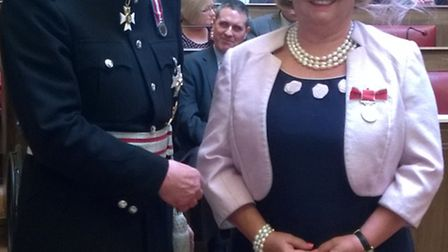 Patsy Glazebrook receives her medal from the Queens representative, Hugh Duberly, Lord Lieutenant of