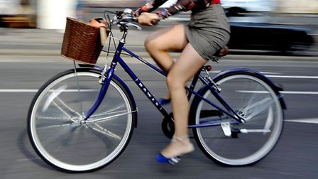 A woman riding a bike (cyclists)