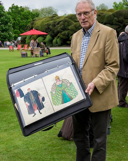 Vic Ranger, from Dunmow, with his collection of costume drawings from the 1930s