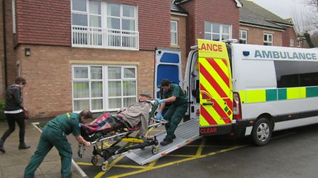 Mr Bryant being transferred from the Roebuck Nursing Home by ambulance
