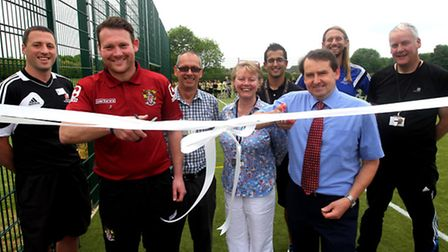 Stevenage manager Darren Sarll with staff at Marriotts School unveiling the new pitch