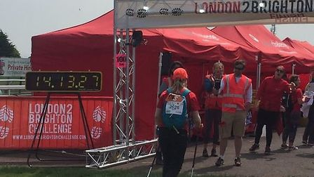 Naomi Parkinson, from Shefford, crossing the finish line in Brighton after nearly 29 hours of walkin