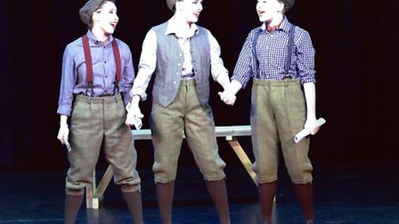 The Footworks trio performing a song from Newsies