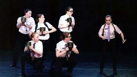 Troupe perfroming a song from Book of Mormon