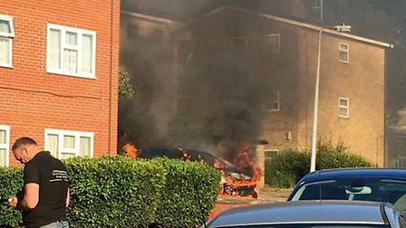 The car on fire in Stevenage's Inskip Crescent yesterday evening.