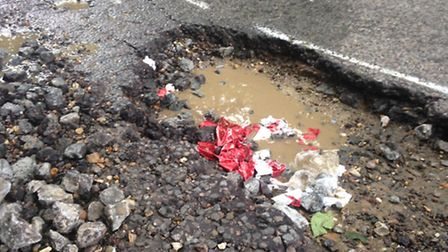The pothole in Stotfold Road before it was filled in.