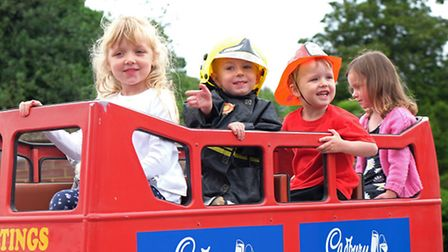 Children on a fairground ride at Hitchin fire station open day