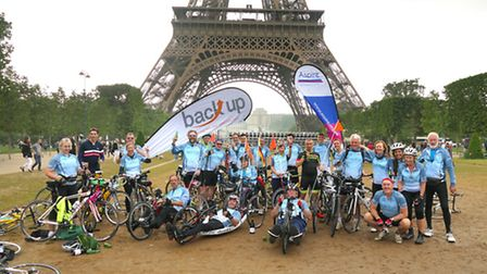 Fundraiser Dave Ralph and his comrades at the foot of the Eiffel Tower in Paris at the end of their