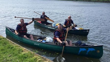 Phil Parker, Neil Norman, Frank Gollogly and Adrian Le Roux in their canoes.