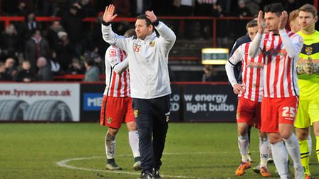 Stevenage boss Darren Sarll and his team clap the home support
