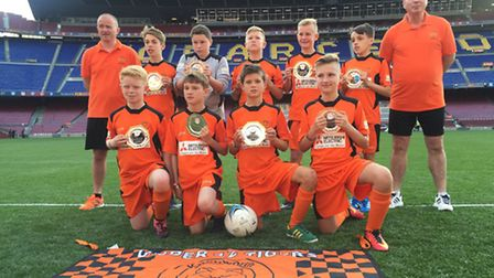 Knebworth Under 12s with their winning trophies inside the Camp Nou