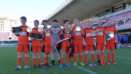 The Tigers line up with their trophies