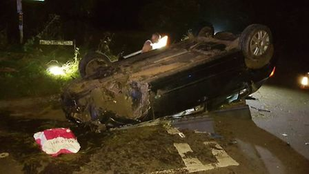 Firefighters made the scene safe after a car overturned in Hitchin Road, just outside Pirton. Pictur