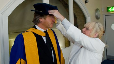 Judy Finnigan helps smarten husband, Richard Madeley, who was awarded an Honorary Doctorate in Lette