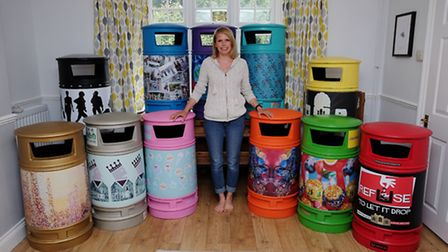 Rachel Capmbell with the colourful bins which will be installed around Hitchin from Friday