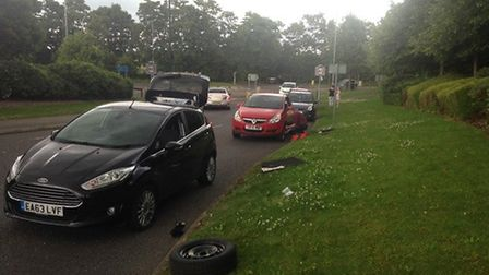 Cars having their tyres changed on the side of Stotfold Road.