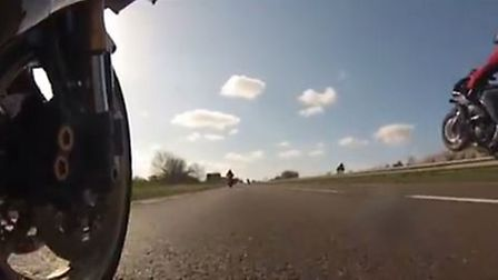 One of the motorcyclists filmed doing a wheelie before police stopped the group on the A1(M).