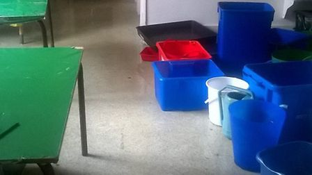 A sea of buckets in a classroom at St Nicholas Church of England Primary and Nursery School in Steve