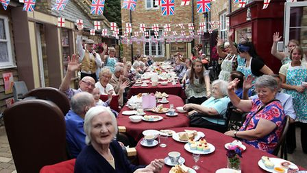 Give us a wave: Folks enjoy the street party at Chase House.