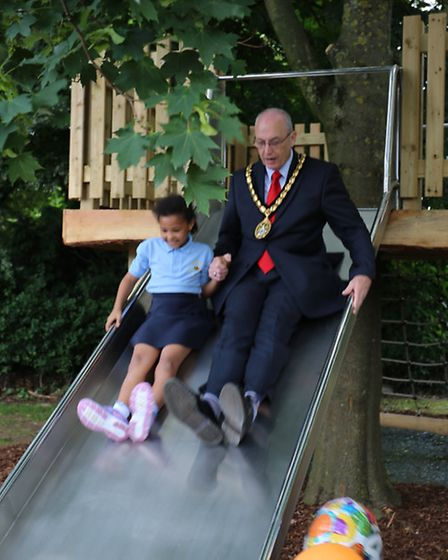 Woolenwick pupil Ritjshua was the first to try out the new slide with Stevenage mayor John Lloyd.