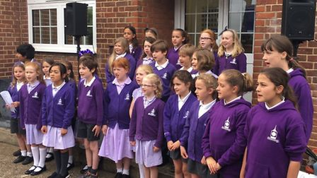 Wilshere-Dacre Year 6s sing at the offical clock tower opening ceremony.