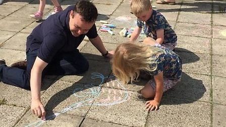 Stevenage MP Stephen McPartland helps some children with their drawing