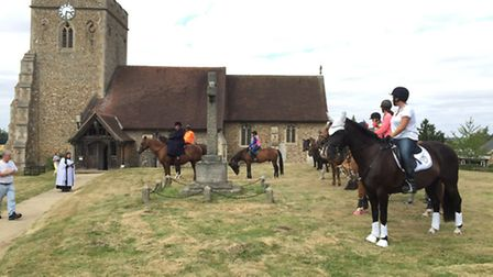 The horses line up before the blessing service at St Ippolyts Church on Sunday.