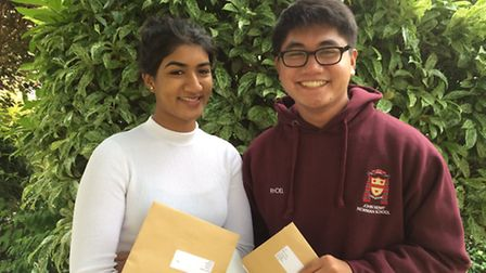 Sudara Senaratne and Rhoel Tupaz from John Henry Newman School in Stevenage with their A-level resul