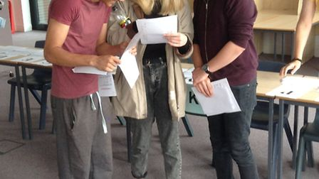 Lenny Ballard, Lizzie Moran and Josh Alderman opening their A-level results at Marriotts School in S