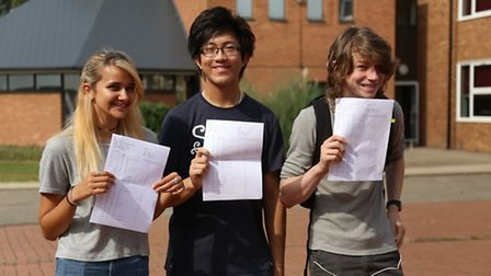 Thomas Alleyne Academy students Nicole Brown, Daniel Zeng and Darren Darby with their GCSE results.