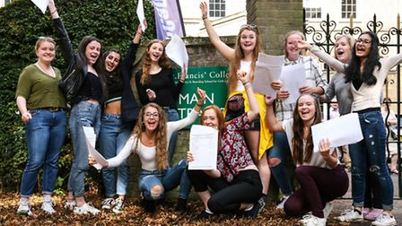 Pupils at St Francis' College celebrate with their GCSE results.