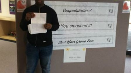 Marriotts School's Abdul-Aziz Ahmed with his GCSE results.