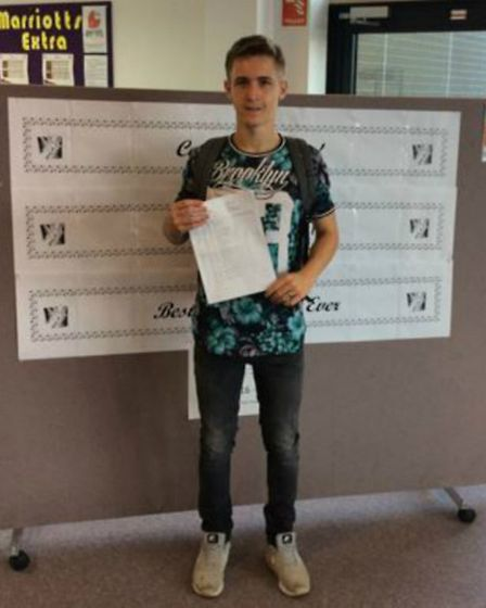 Marriotts School's Cameron Potasnick with his GCSE results.
