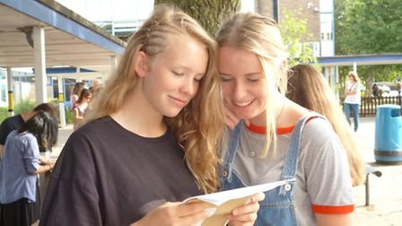 Student Emily Burton reading her results with Emily Noon from the John Henry Newman School.