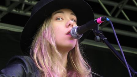 Roxy Searle performing on stage.
