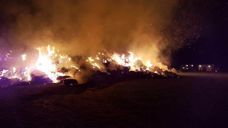 The scene at Gosmore this morning, where 400 tonnes of straw caught fire. Photo: @HertsFRSControl