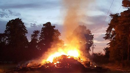 The scene at Gosmore this morning, where 100 tonnes of straw caught fire. Photo: @HertsFRSControl