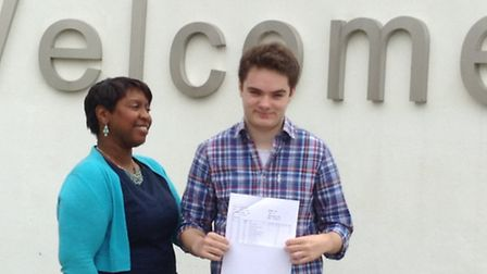 Barclay student Andrew Wallace with his A-level results alongside the Stevenage school's head Jacqui