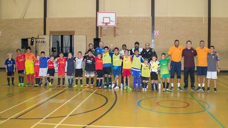 The kids line up at the Letchworth Olympic Games with KFA project volunteers Nav Singh, Barry Guildf