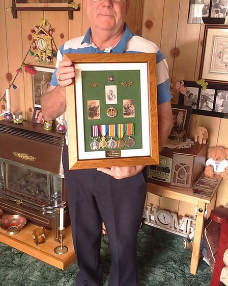 Richard Mott with medals belonging to his grandfather James Pearman