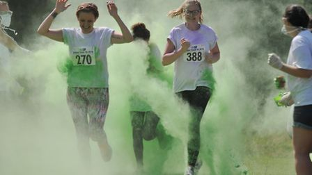 Participants reach the second colour station of the Garden House Hospice Care Colour Clash 5k run in