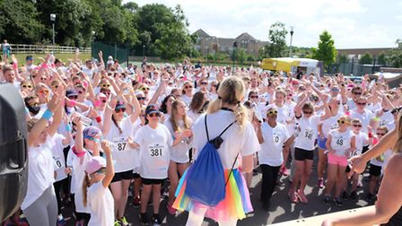 Participants warm up for the first ever Garden House Hospice Care Colour Clash 5k run in Stevenage.