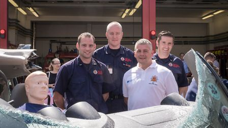 George Bowers, Mark Webb, Mark Curtis and Kevin Jenner with the demo car showing how a roof fold, da